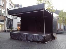 Podiumwagen glimlach 5 Boogpodium podia podiumwagen stage huren Evento